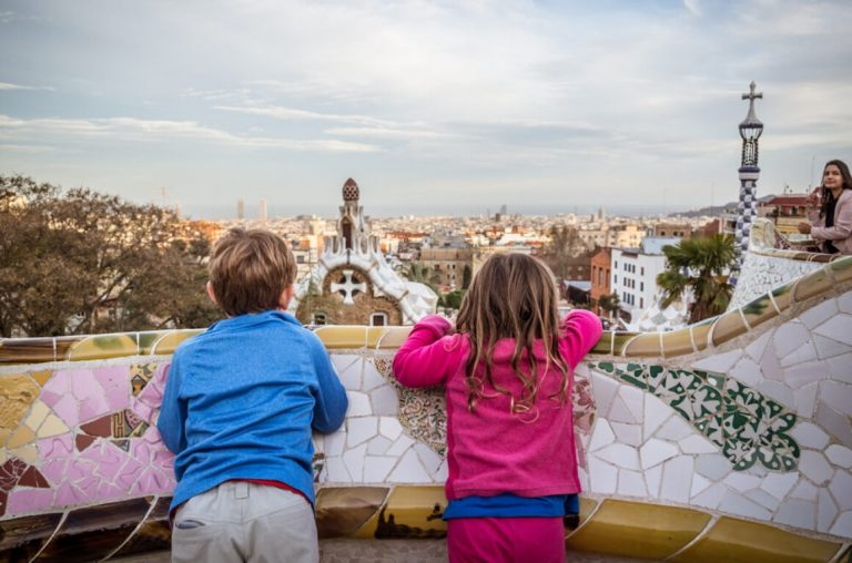 Two kids enjoying a view of Barcelona from Parc Guell