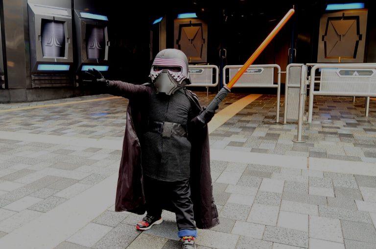 A little boy dresses as Kylo Ren doing the 'force'