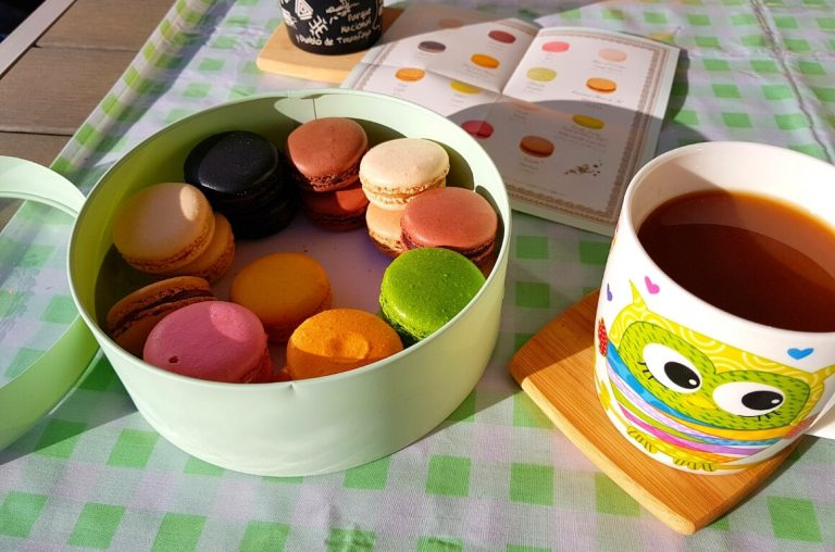 French macarons and a cup of tea on a table