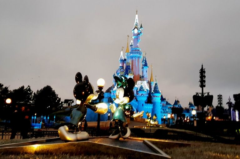 Mickey and Minnie Mouse in front of the castle at Disneyland Paris