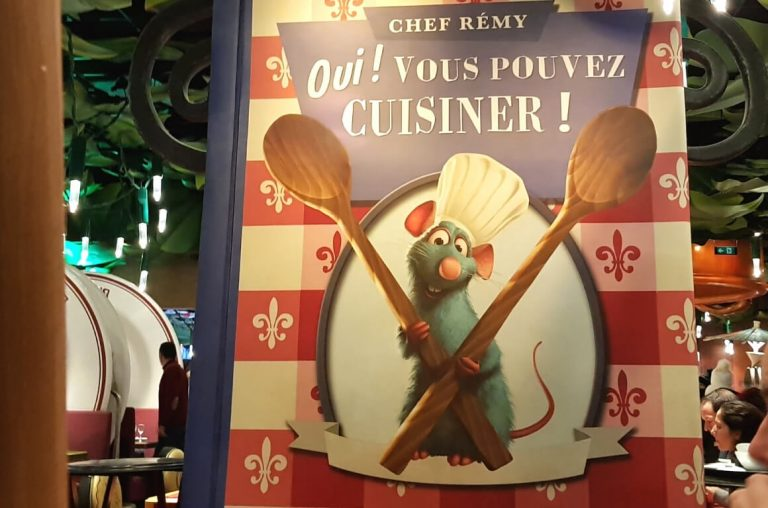 The sign inside Bistro Chez Remy featuring the chef mouse