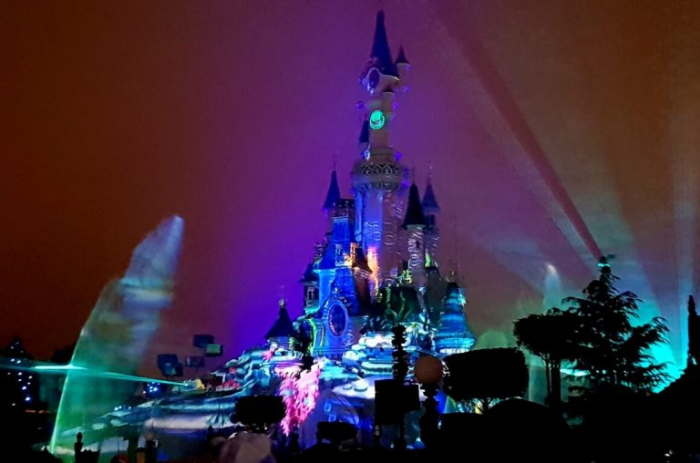 Lights and fireworks behind the castle at Disneyland Paris