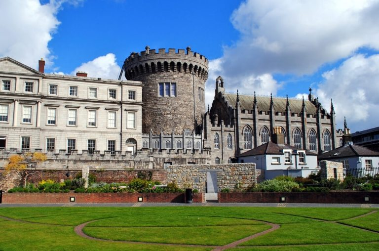 A picture of Dublin Castle with the green grass in the gardens in front