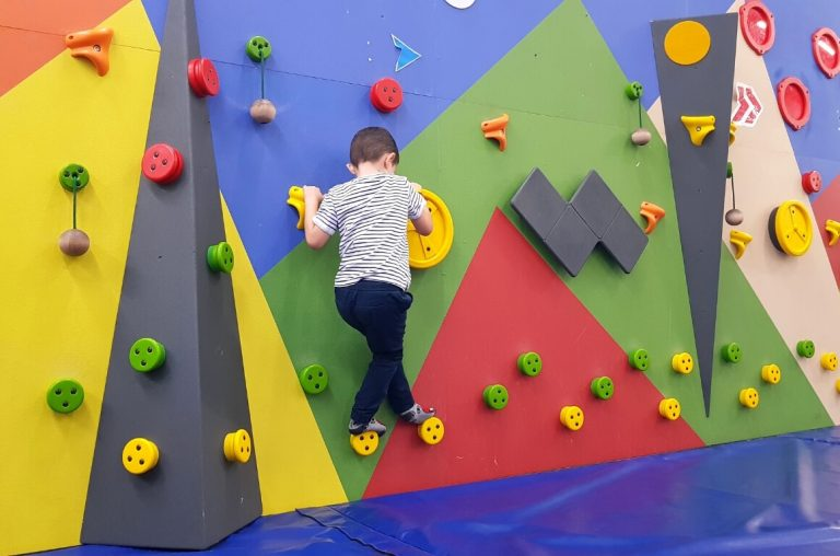 A picture of a boy on a climbing wall in Explorium in Dublin