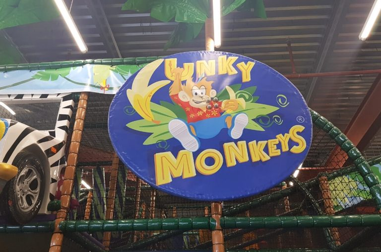 The funky Monkey's sign on the side of the soft play area in this Dublin kids venue
