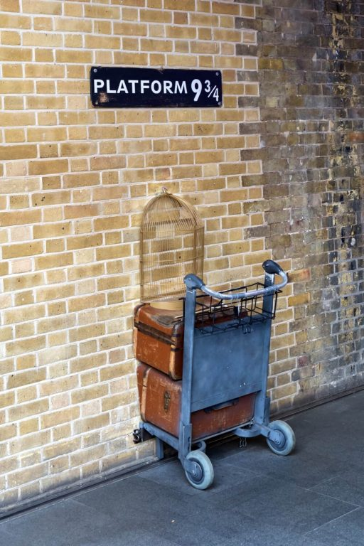 A picture of a luggage trolley half in a wall at platform nine and three quarters for Harry Potter.