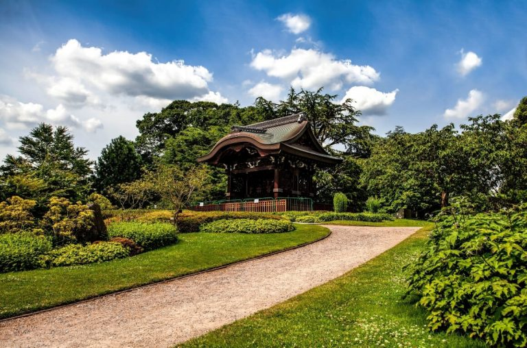 A picture of the Japanese Gate among beautiful gardens at Kew Gardens, London