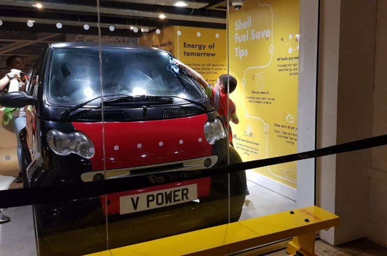 A picture of kids washing a car at Kidzania London.