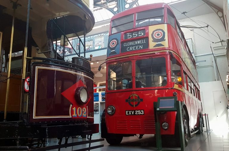 A picture of old double decker buses in the London Transport Museum.