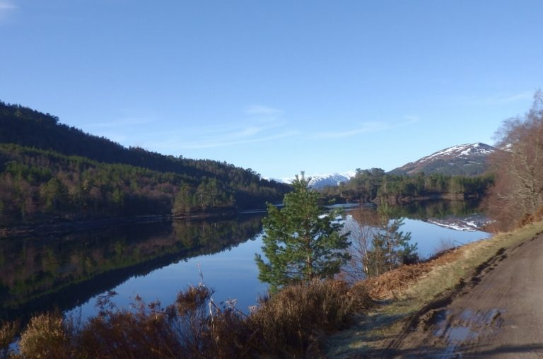 A picture of a still lake in the Scottish Highlands