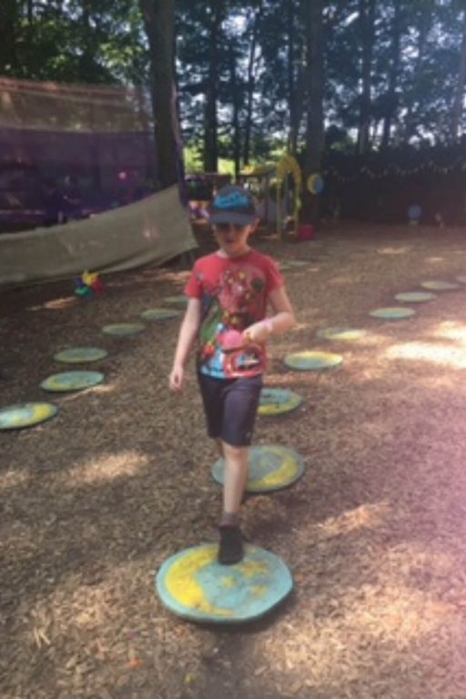 AA picture of a boy on stepping stones at Bewilderwood