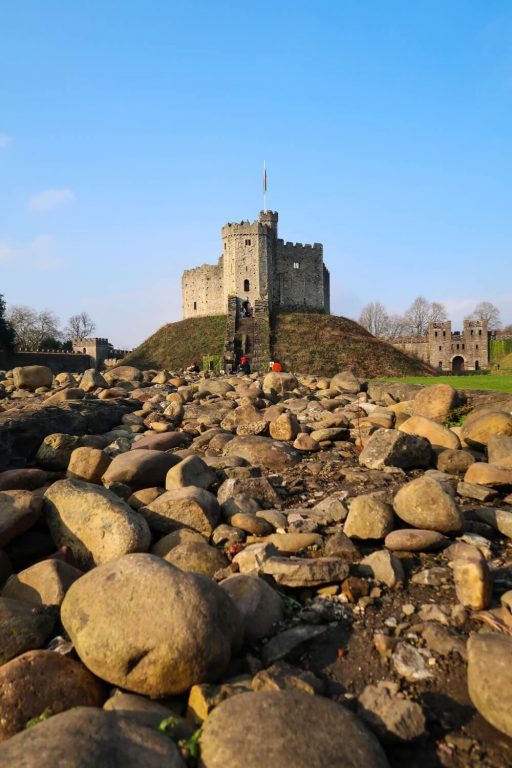 A picture of the Norman Keep at Cardiff Castle with blue skies overhead