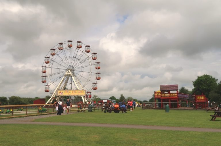 A picture of the big wheel and green spaces at Folly Farm, West Wales