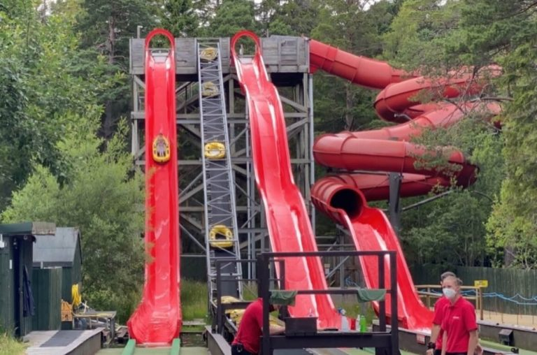 A picture of the red water slides at the Landmark Forest Adventure Park
