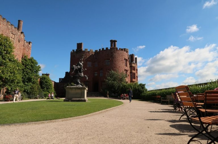 A picture of the main mansion house at Powis Castle with blue skies overhead