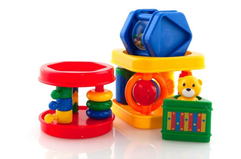 A picture of brightly coloured baby toys on a white background