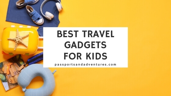 A picture of a kids suitcase and other travel accessories with text overlay saying Best Travel Gadgets for Kids